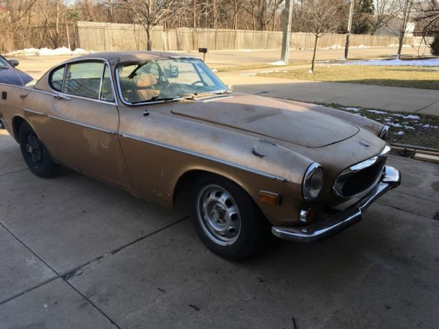 1971 Gold Metallic Volvo P1800E Coupe with Tan interior
