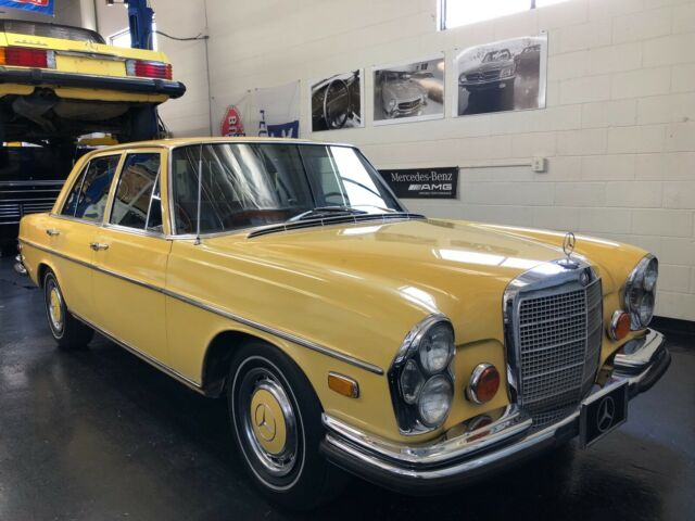 1973 Yellow Mercedes-Benz 200-Series W108 Sedan with Brown interior