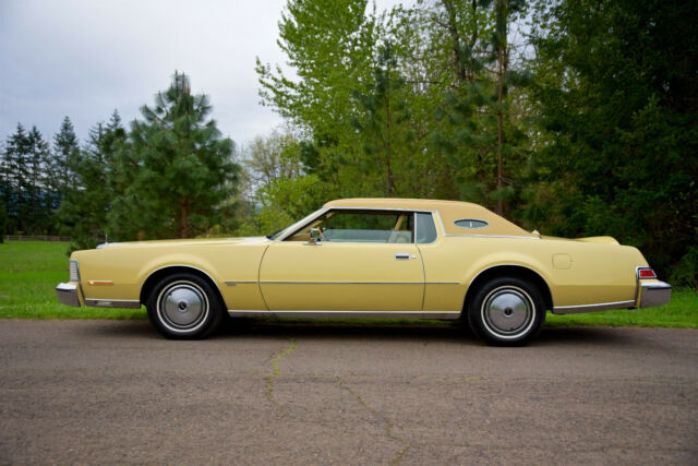 1974 Yellow Lincoln Continental Sedan with Gold interior