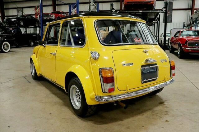 1975 Yellow Mini Cooper Coupe with Blue interior