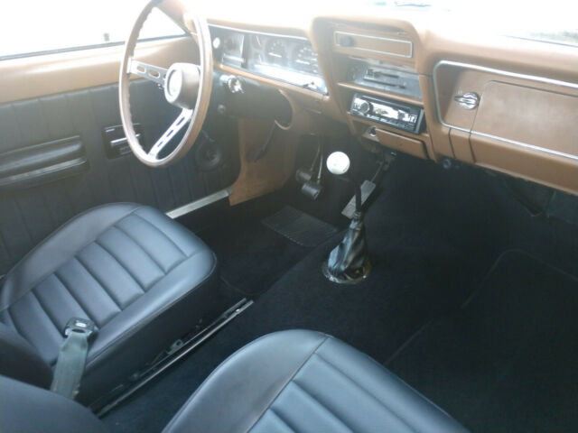 1976 Yellow AMC Hornet Sedan with Black interior
