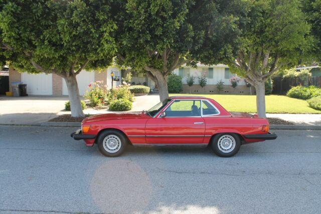 1976 Mercedes Benz 450SL, Red with Black interior.