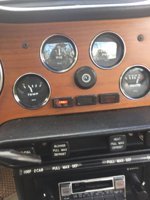 1976 Burgundy Triumph TR-6 Convertible with Tan interior