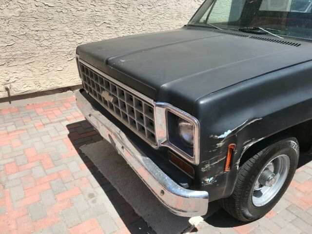 1977 Black Chevrolet C-10 Standard Cab Pickup with Black, Red interior