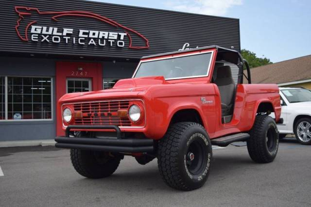 1977 Red Ford Bronco -- SUV with Gray interior