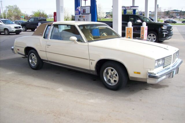 1980 Yellow Oldsmobile Cutlass Coupe with Gold interior
