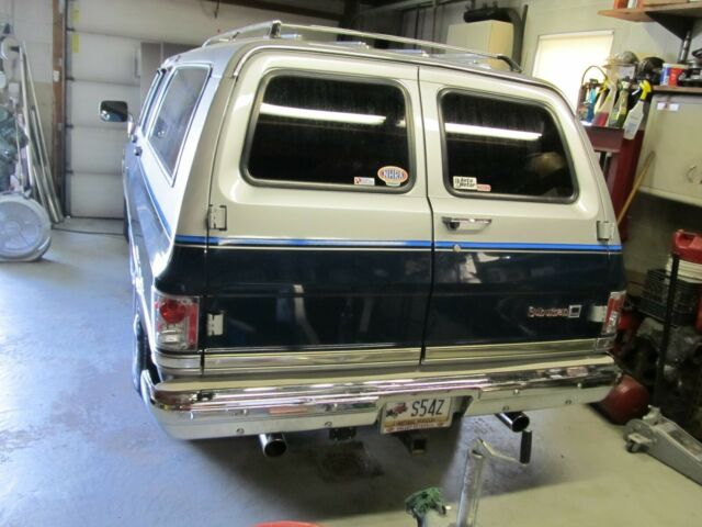 1984 Silver GMC Suburban SUV with Blue interior
