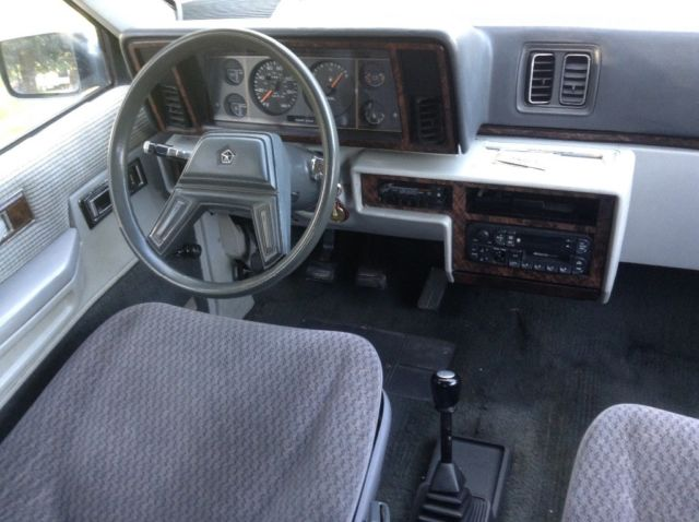 "1984 Silver Plymouth Voyager ""Magicwagon"" Minivan with Gray interior"