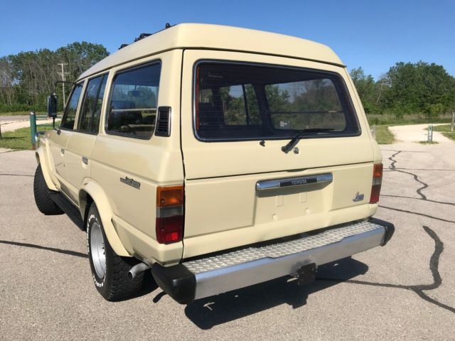 1984 beige Toyota Land Cruiser HJ60 SUV with gray interior