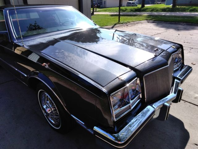 1985 Dark Charcoal Grey Firemist Metallic Buick Riviera Hardtop Coupe Coupe with Burgundy Red Custom Cloth / Velour interior