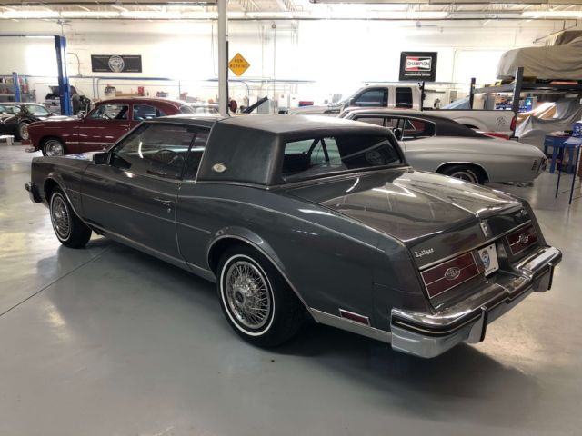 1985 Dark Grey Firemist Buick Riviera Coupe with Burgundy interior