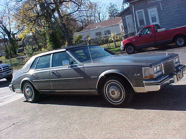 1985 GrayWITH  BLACK  CARRIAGE  ROOF Cadillac Seville Sedan with Gray interior