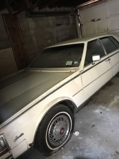 1985 Cadillac Seville Burgundy Leather Interior, White Exterior