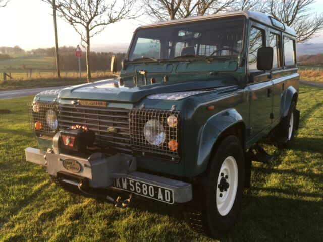 1985 Green Land Rover Defender 110 Extended Passenger Van with Brown interior