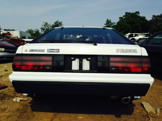 1985 White Mitsubishi Other Coupe with Burgundy interior