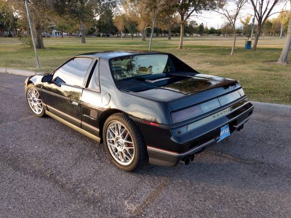 1986 Black Pontiac Fiero Coupe with Gray interior