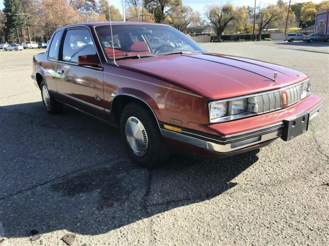 1986 Red Oldsmobile Calais -- with Red interior