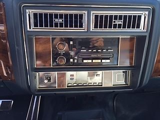 1987 Blue Cadillac Fleetwood Sedan with White interior