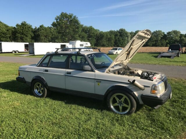 1987 White Volvo 240 Coupe with Blue interior