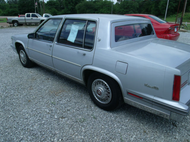 1988 Gray Cadillac DeVille Sedan with Red interior