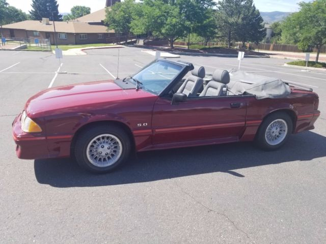 1988 Burgundy Ford Mustang GT Convertible with red interior