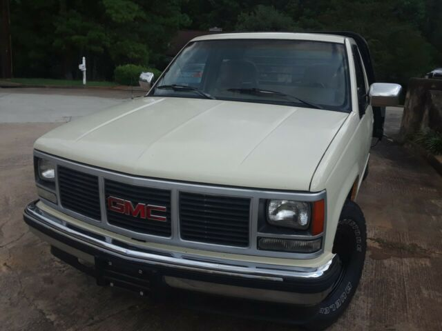 1988 cream GMC Sierra 3500 Cab and Flat Bed with Brown interior