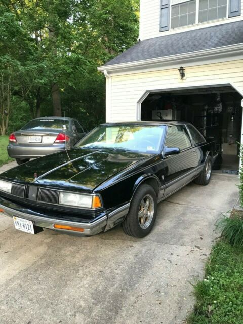 1988 Black Oldsmobile Eighty-Eight Coupe with Tan interior