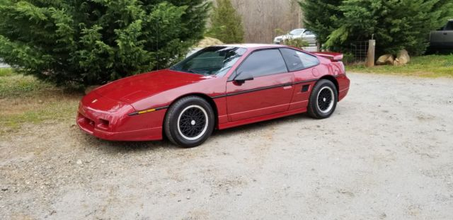 1988 Red Pontiac Fiero Coupe with Gray interior