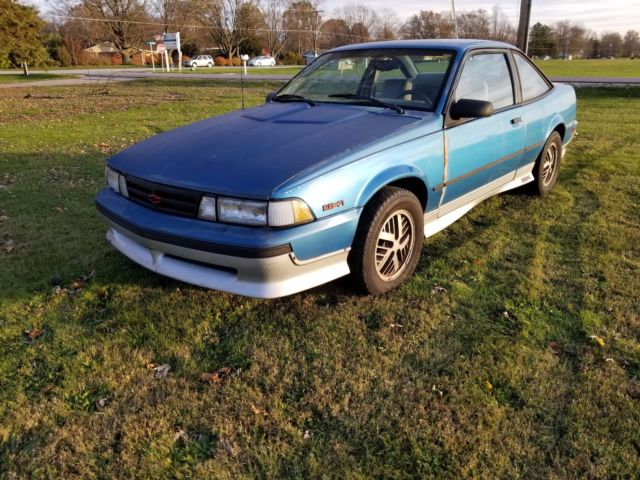 1989 Blue Chevrolet Cavalier Coupe with Gray interior
