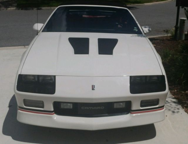 1989 white Chevrolet Camaro IROC Convertible with red interior