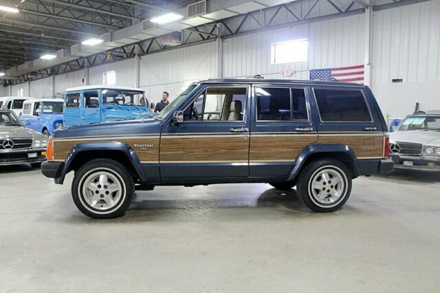 1989 Blue Jeep Wagoneer Limited SUV with Tan interior