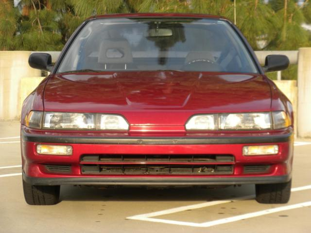 1990 Torino Red Pearl Acura Integra Hatchback with Black interior