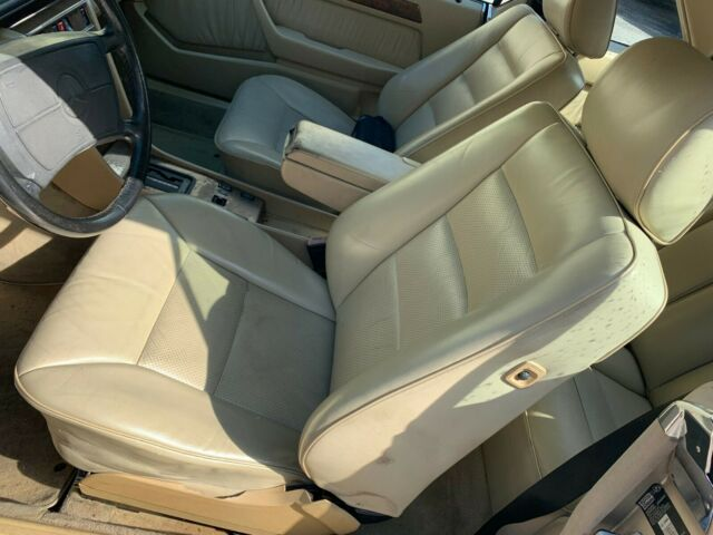 1990 Gold Mercedes-Benz 300-Series with Tan interior