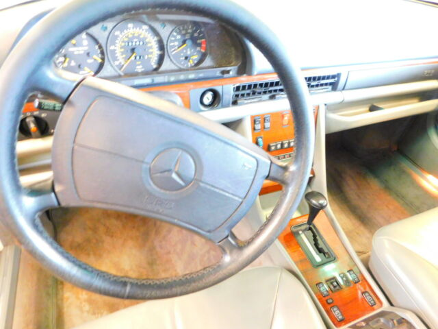 1990 White Mercedes-Benz 400-Series Sedan with Tan interior