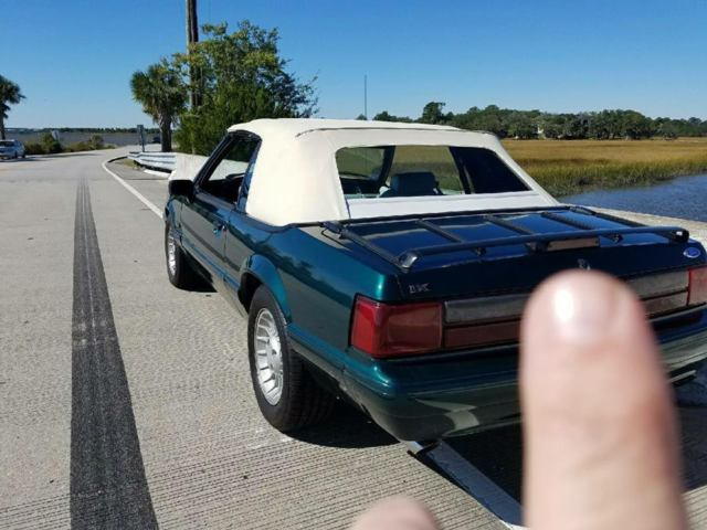 1990 Dark Emerald Green Ford Mustang Convertible with White interior