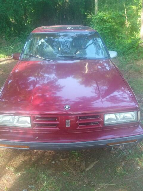 1990 Red Oldsmobile Ninety-Eight 4 door with Gray interior