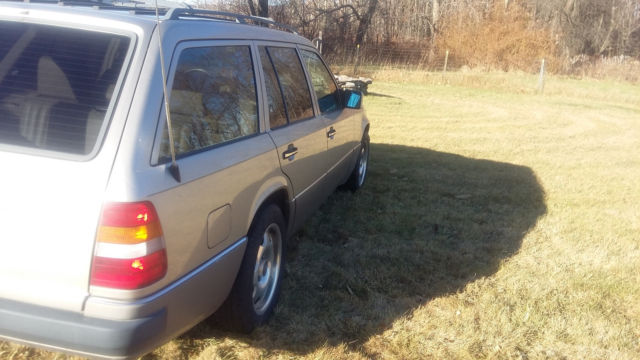 1991 Gold Mercedes-Benz 300-Series Wagon with Tan interior