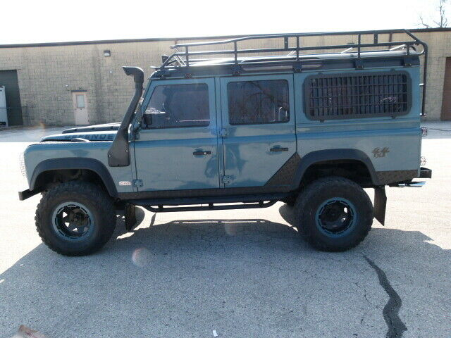 1993 Blue Land Rover Defender 110 SUV with Gray interior