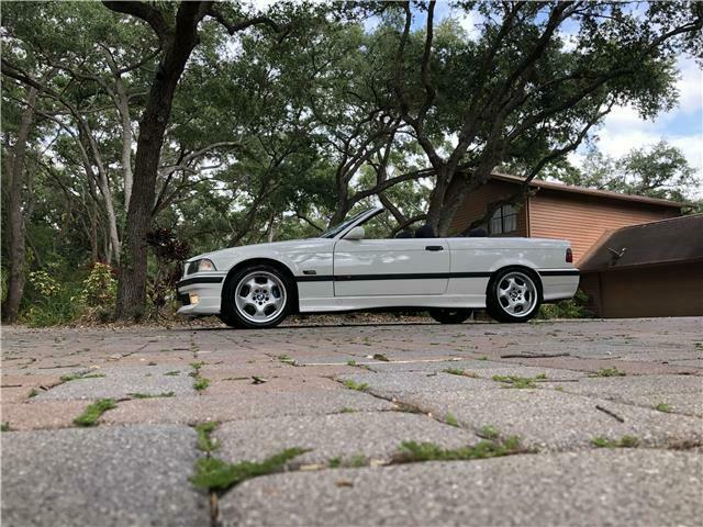 1994 White BMW 3-Series -- with Blue interior