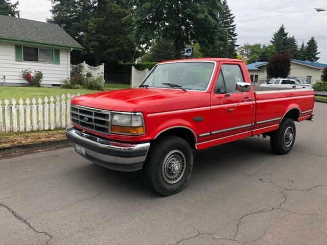 1994 Red Ford F-250 Standard Cab Pickup with Gray interior
