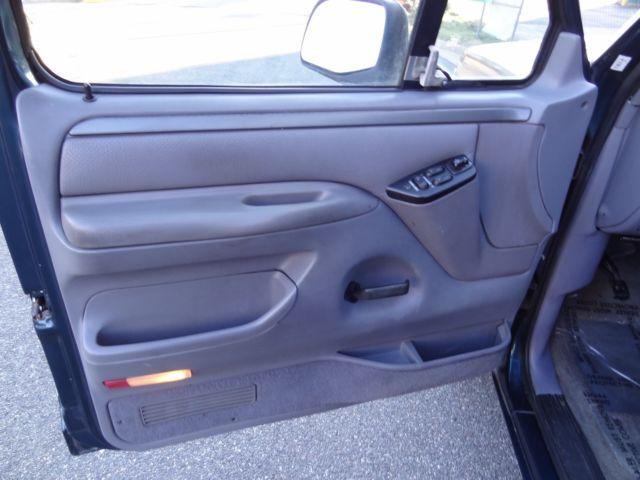 1994 White Ford F-150 Crew Cab Pickup with Gray interior