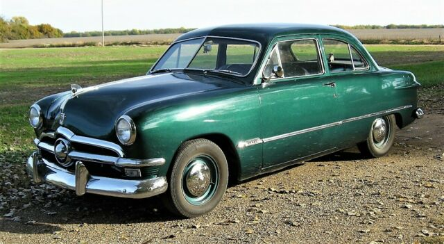 1950 Green Ford Custom Deluxe Sedan with Gray interior