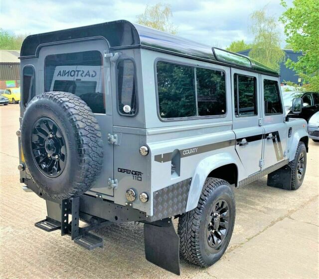 1994 Gray Land Rover Defender 110 SUV with Burgundy interior