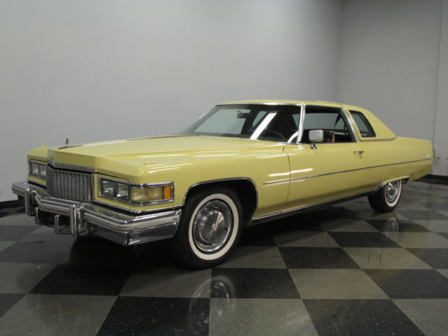 1975 Yellow Cadillac DeVille Coupe with Brown interior