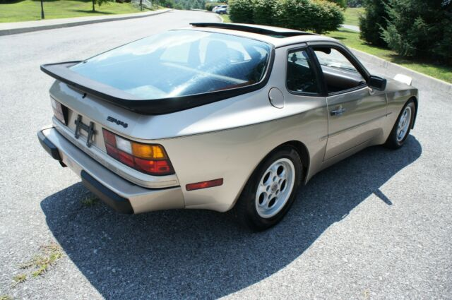 1985 Gold Porsche 944 944 Coupe Hatchback with Brown interior