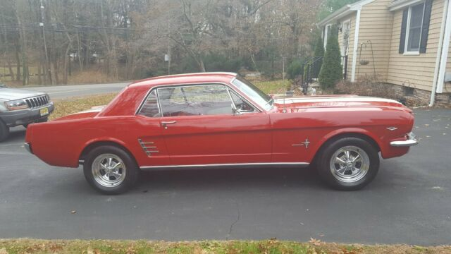 1966 Red Ford Mustang Coupe with Red/White interior