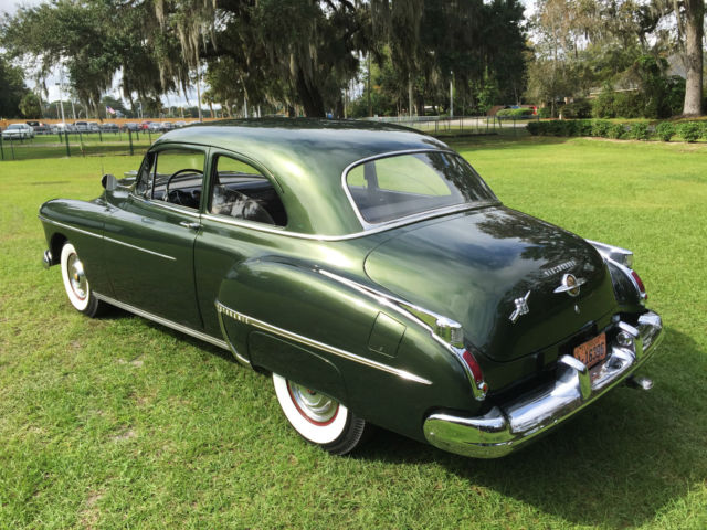 1950 Green Oldsmobile Eighty-Eight Rocket 88 Sedan with Gray interior