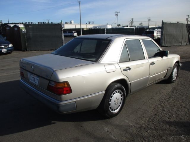 1991 Gold Mercedes-Benz 300-Series 4 Dr Sedan with Brown interior