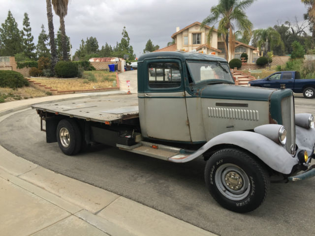 Classic 1935 gmc dually flat bed pickup sitting on a hot for Classic beds for sale