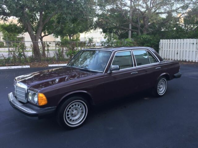 1985 Burgundy Mercedes-Benz 300-Series W123 Sedan with Tan interior
